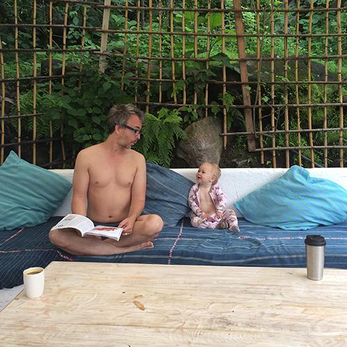 Papa And Iza Drink Tea And Read The Magazine.